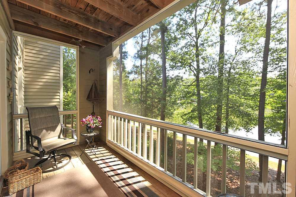 Deck with a view of the lake is screened in
