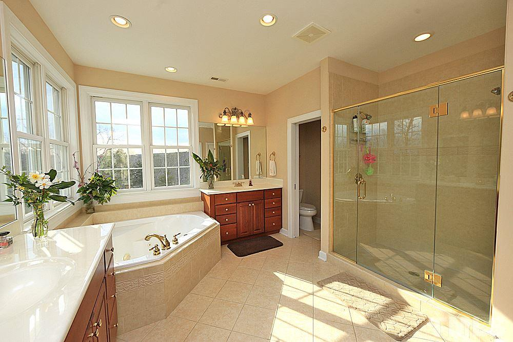 Garden tub and separate shower. Two separate vanities.  Lots of natural light