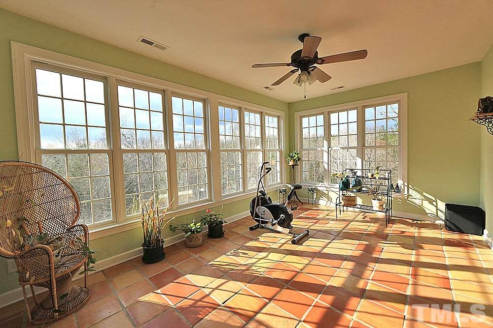 Hardwood floors, room open to sunroom, gas log fireplace