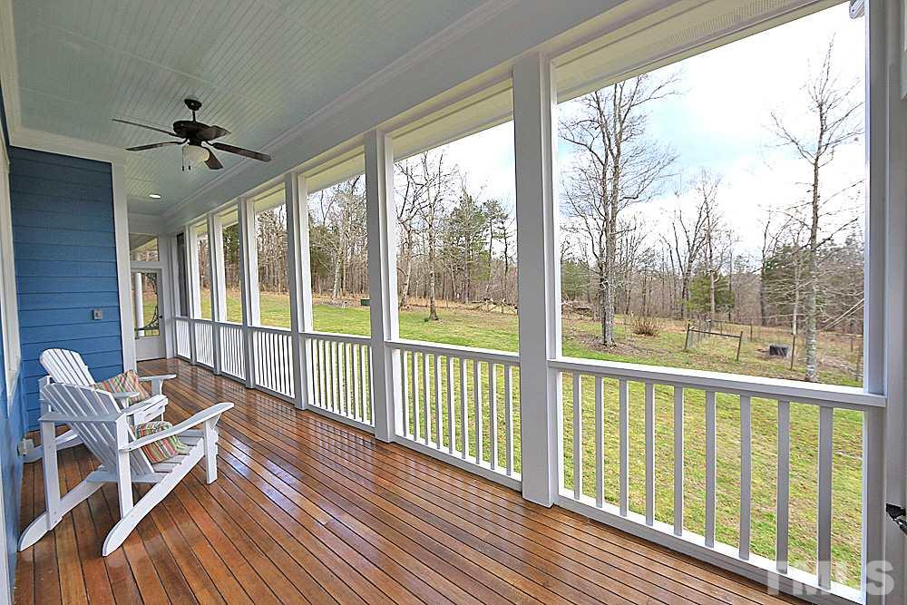 Large wrap around mahogany porch with screened in area