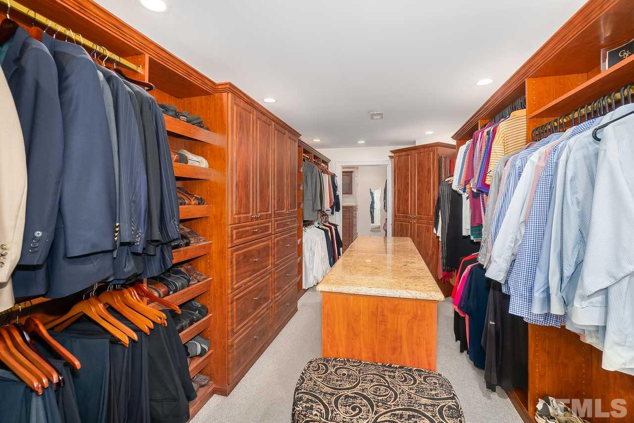Part one of two of this very impressive lower level walk-in closet, just awesome!