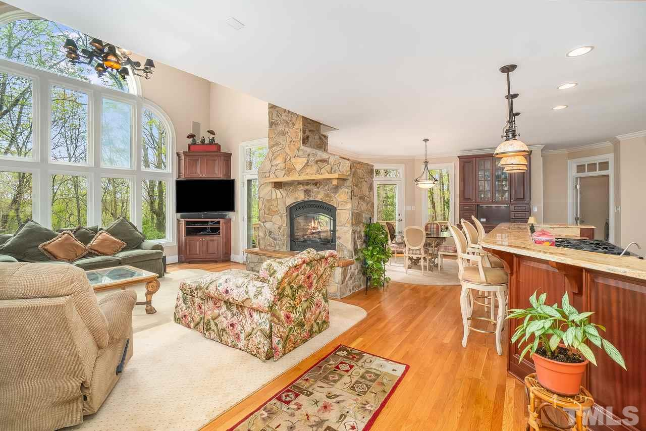 Family room open to kitchen, stone fireplace and breakfast nook