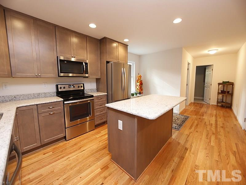 Beautiful gray-tone wood cabinets and granite counters.