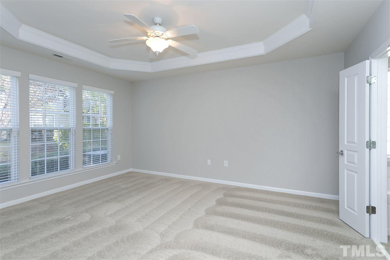 Relax in the spacious master bedroom with trey ceiling complete with a large walk-in closet