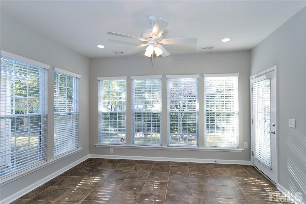 Light fills the sunroom - a floor plan upgrade when built.  Tiled floor, lots of windows with easy access to the patio and backyard.