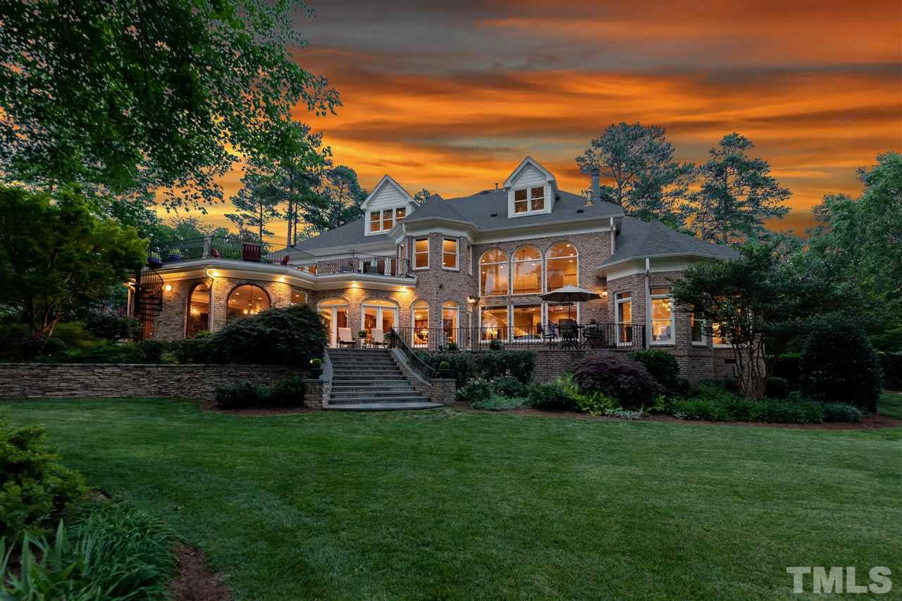 Enjoy Gorgeous Sunsets from 1900 SF of Multi-Level Outdoor Living Space. Upper Terrace & Raised Patio overlooking the Golf Course are connected by a Spiral Staircase for Entertaining Flow.