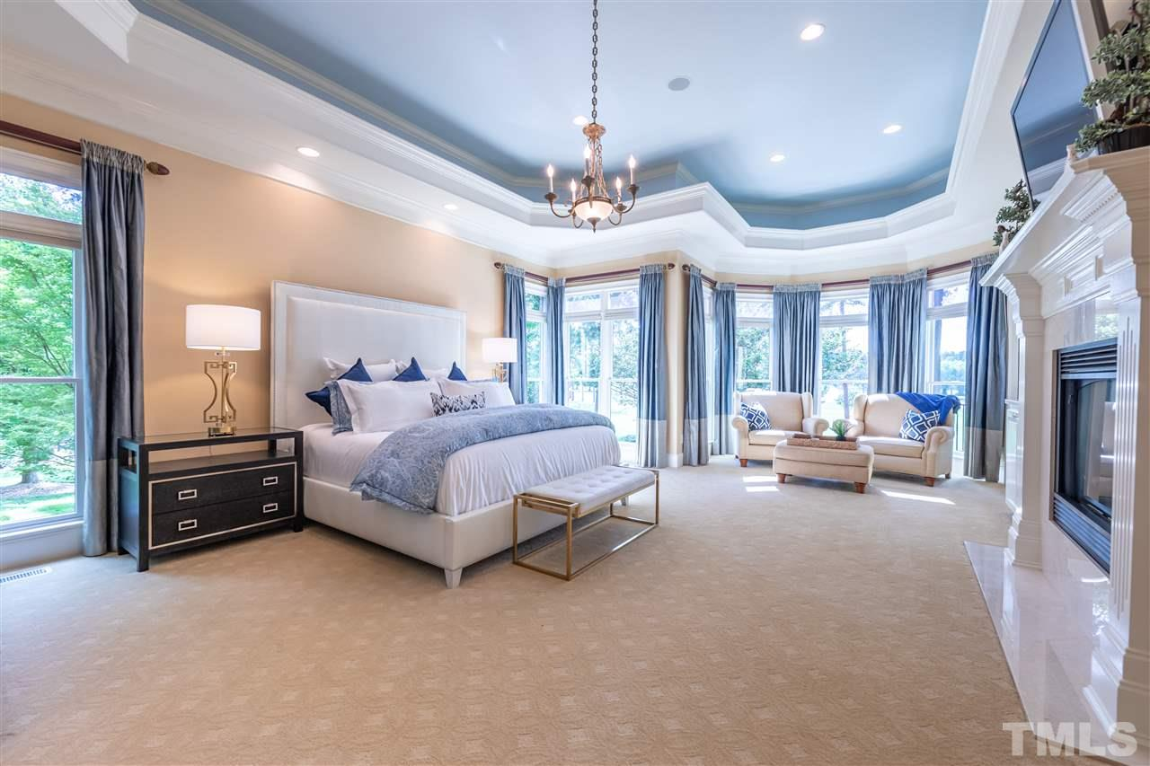The Master Bedroom features a Fireplace, Tray Ceiling & Sitting Area. Two Professionally Designed Walk-In Closets complete this Elegant Master Suite. Gorgeous Views with Private Access to Elevated Patio.