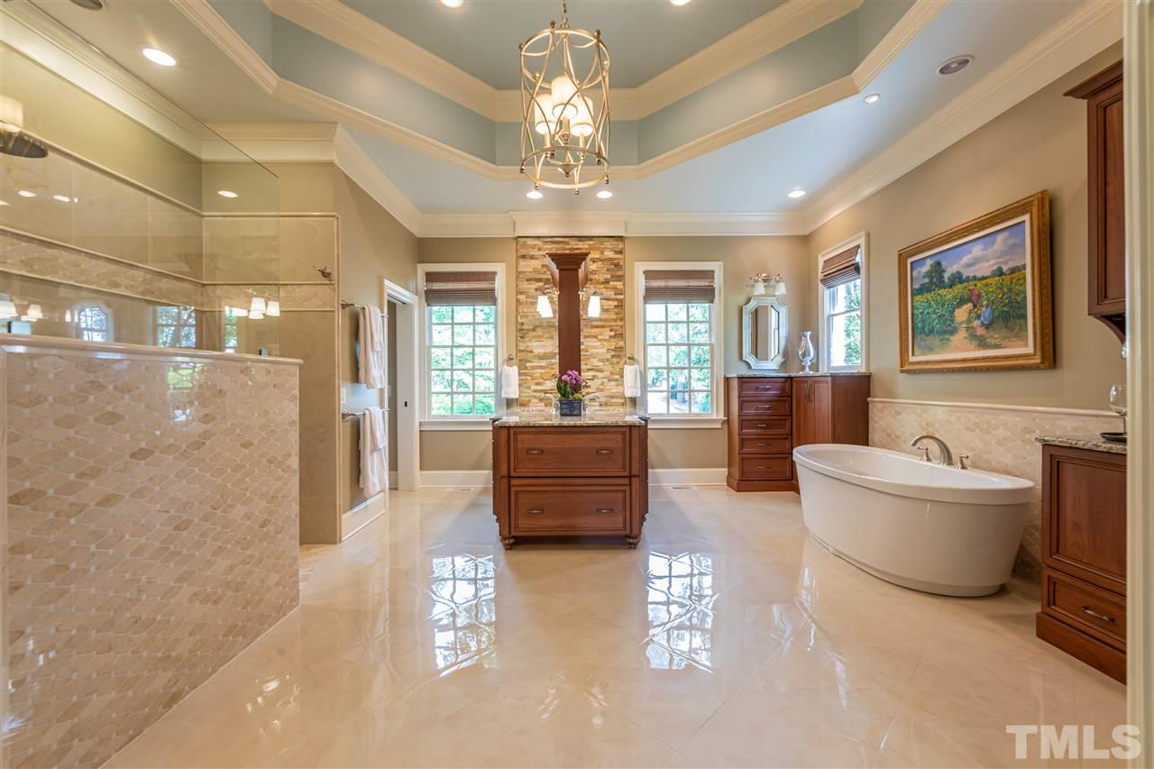 Award Winning Master Bath Remodel with Heated Floors, Oversized Walk In Shower, Luxurious Soaking Tub, Separate Custom Vanities, TV Mount, and Coffee/Wine Bar with Refrigerator.