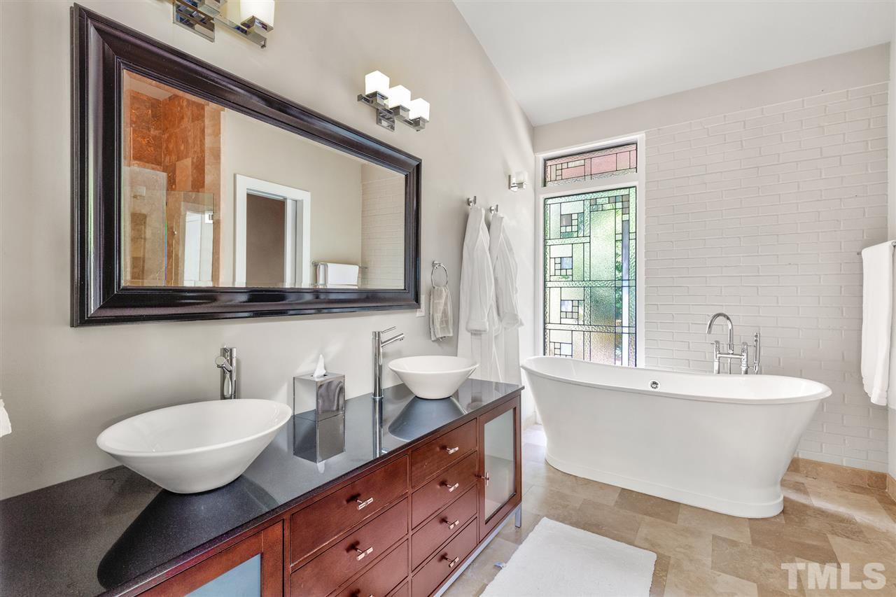 Beautifully updated with separate bathtub and large walk-in shower.