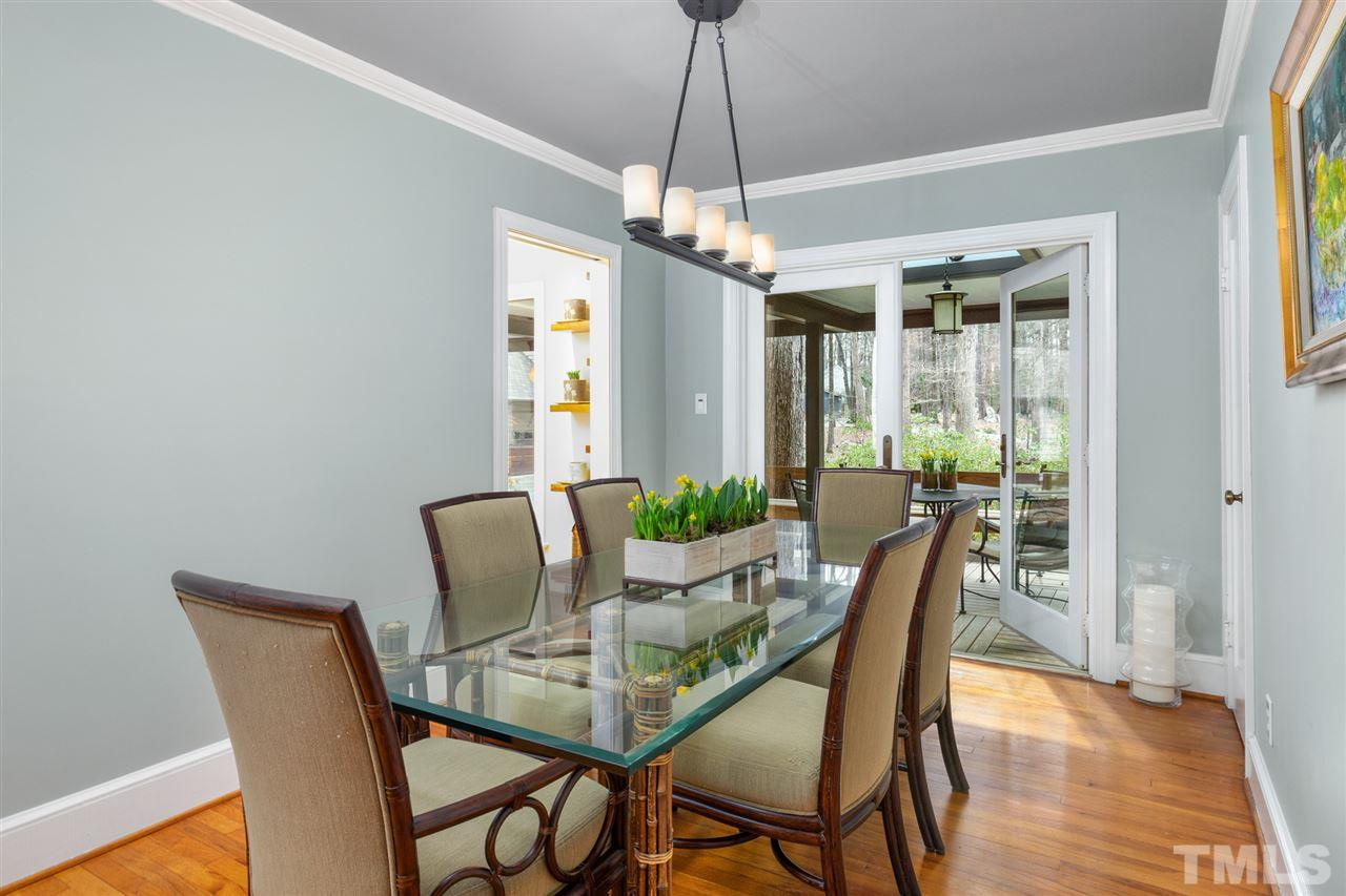 Dining room is designed for entertaining with a door out to the covered deck.