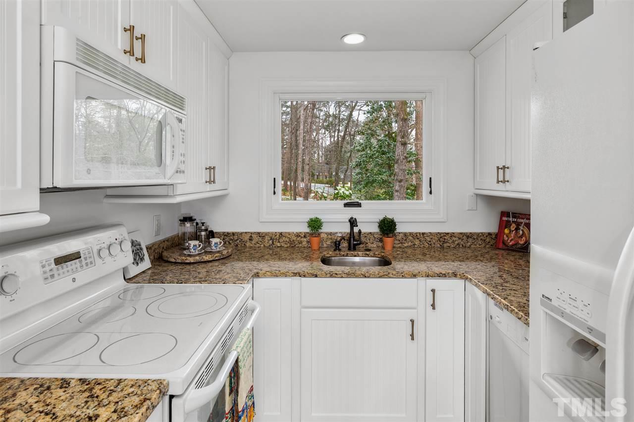 Guests will enjoy the convenience of their own entrance as well as this fully uplifted kitchen.