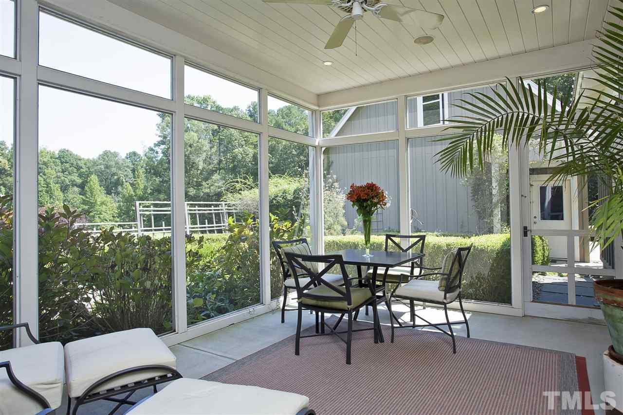 Just off the dining room, the screened porch offers one of many ways to enjoy the outdoors.