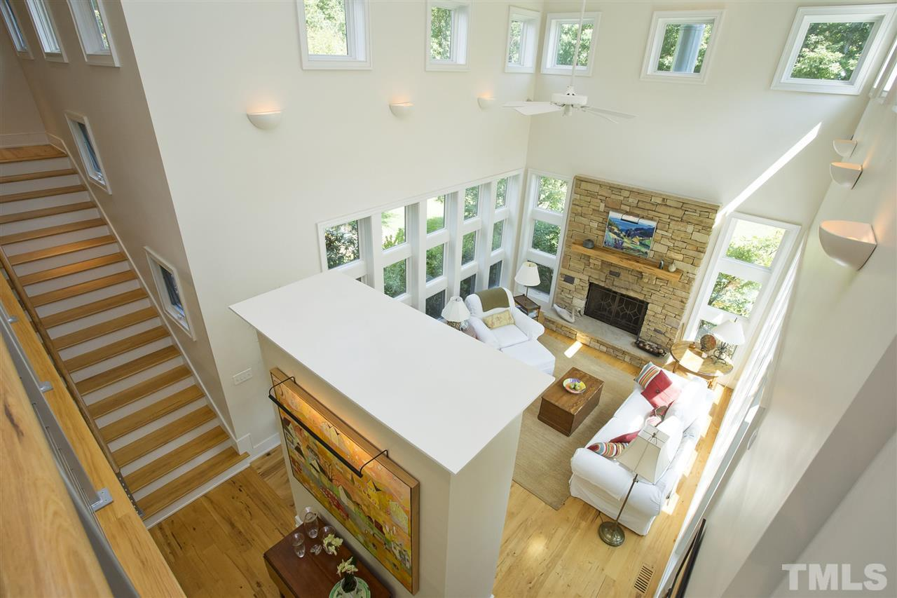 this view from the bridge shows the two story living room.
