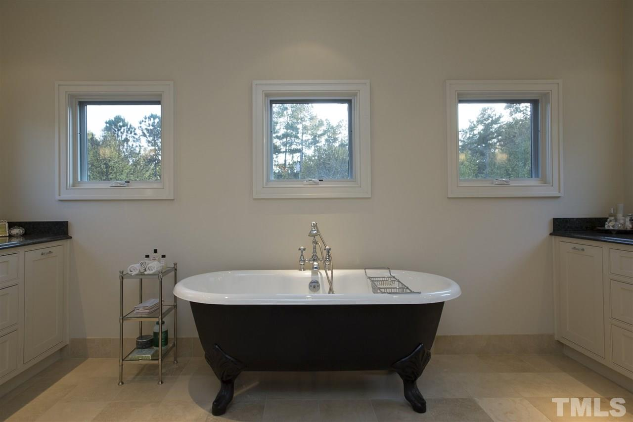Your first view in the Master Bath is the Porcher soaking tub. Imagine yourself relaxing here.