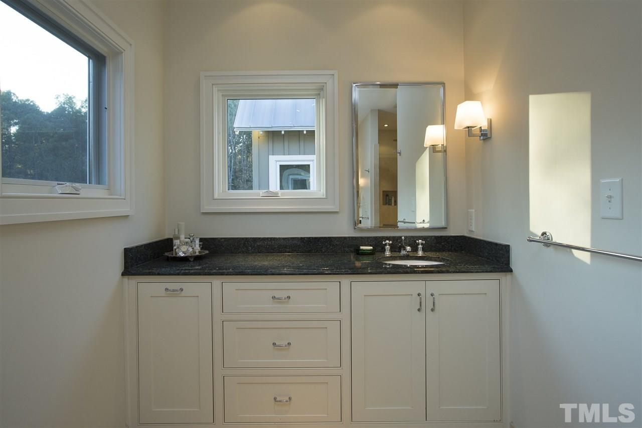 Twin vanities flank each side of the master bath.