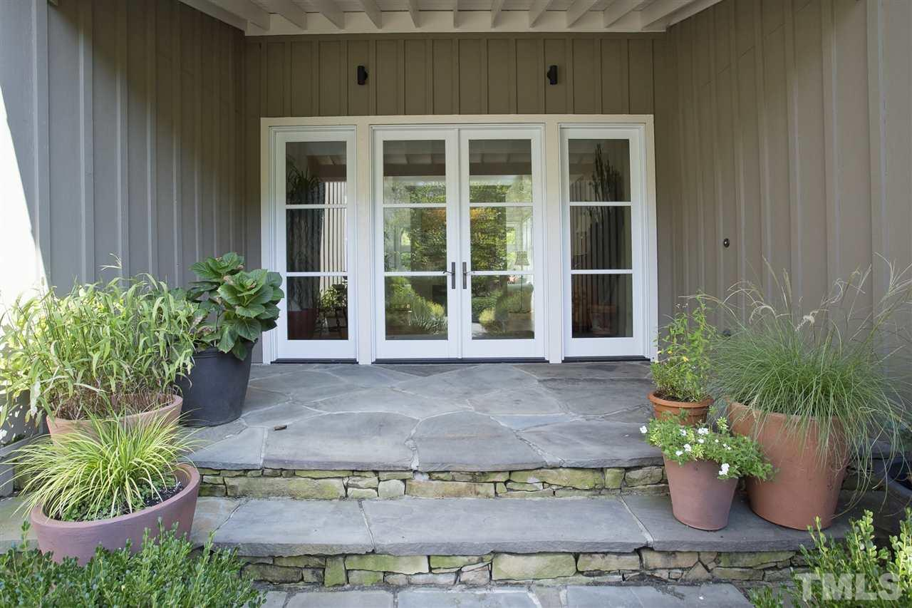 Pennsylvania bluestone floors on all the porches and stepping stones.  The lovely entry advises you are about to walk into a special home.