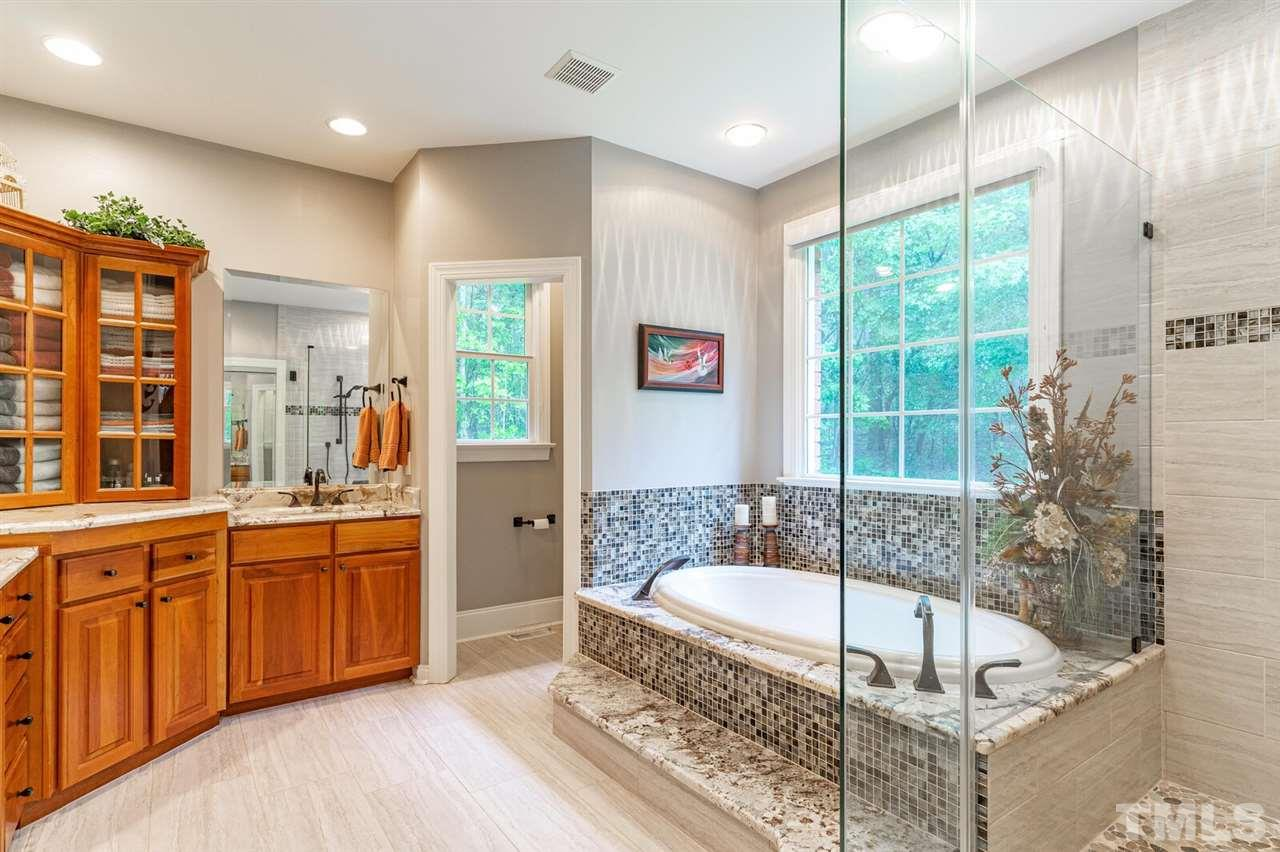 Owner Suite Bathroom, recently renovated to this amazing spa like space. Beautiful tile and stone.