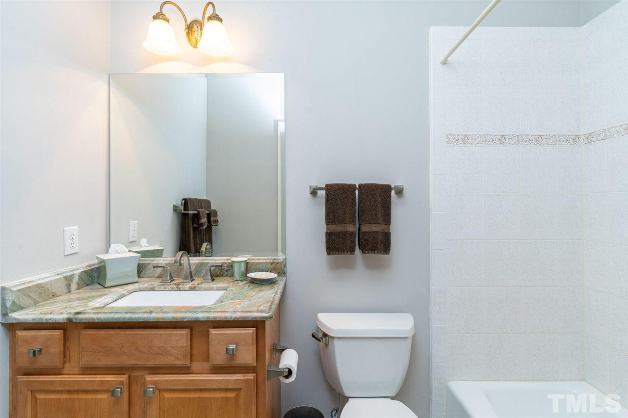 Second Bedroom Bathroom with high end granite and  tub shower.