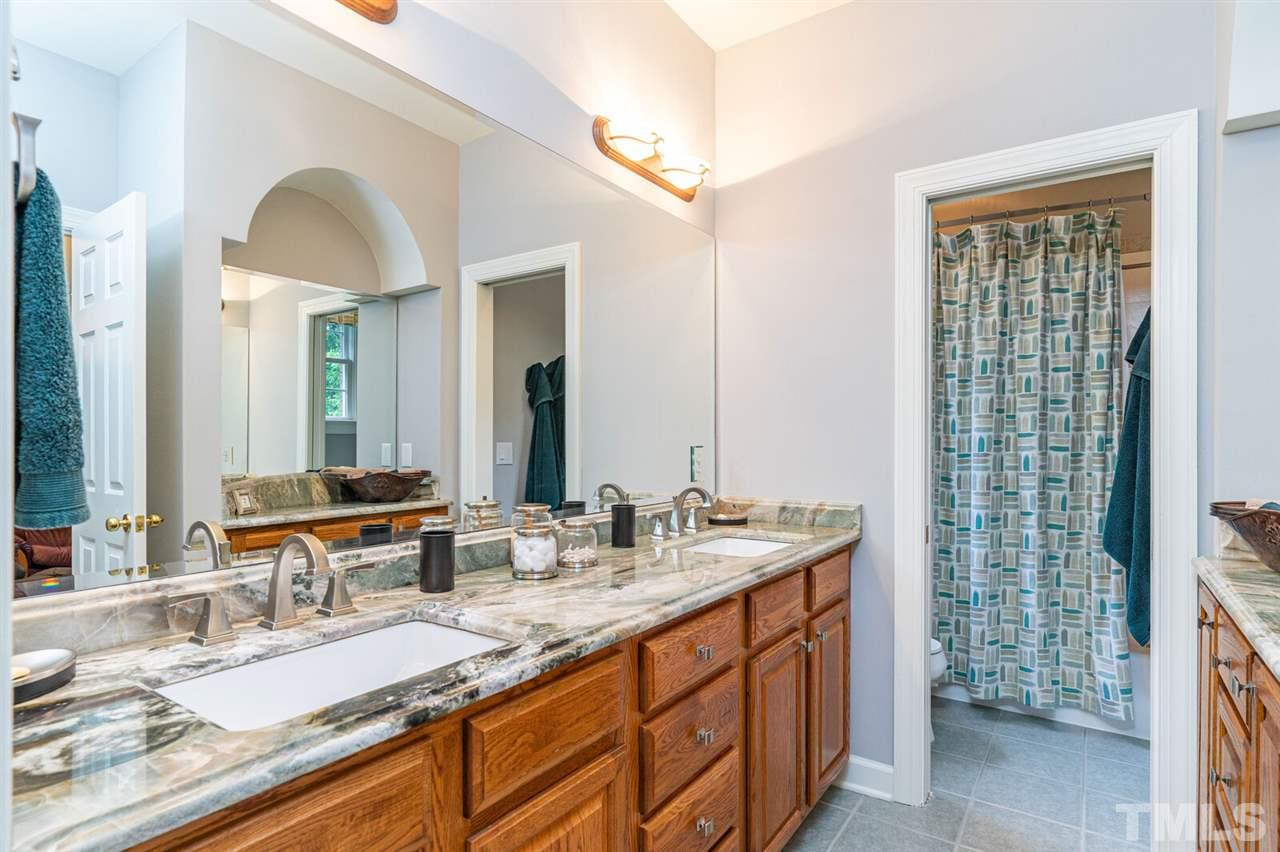 Third Bedroom bathroom High end Granite and tub/shower.