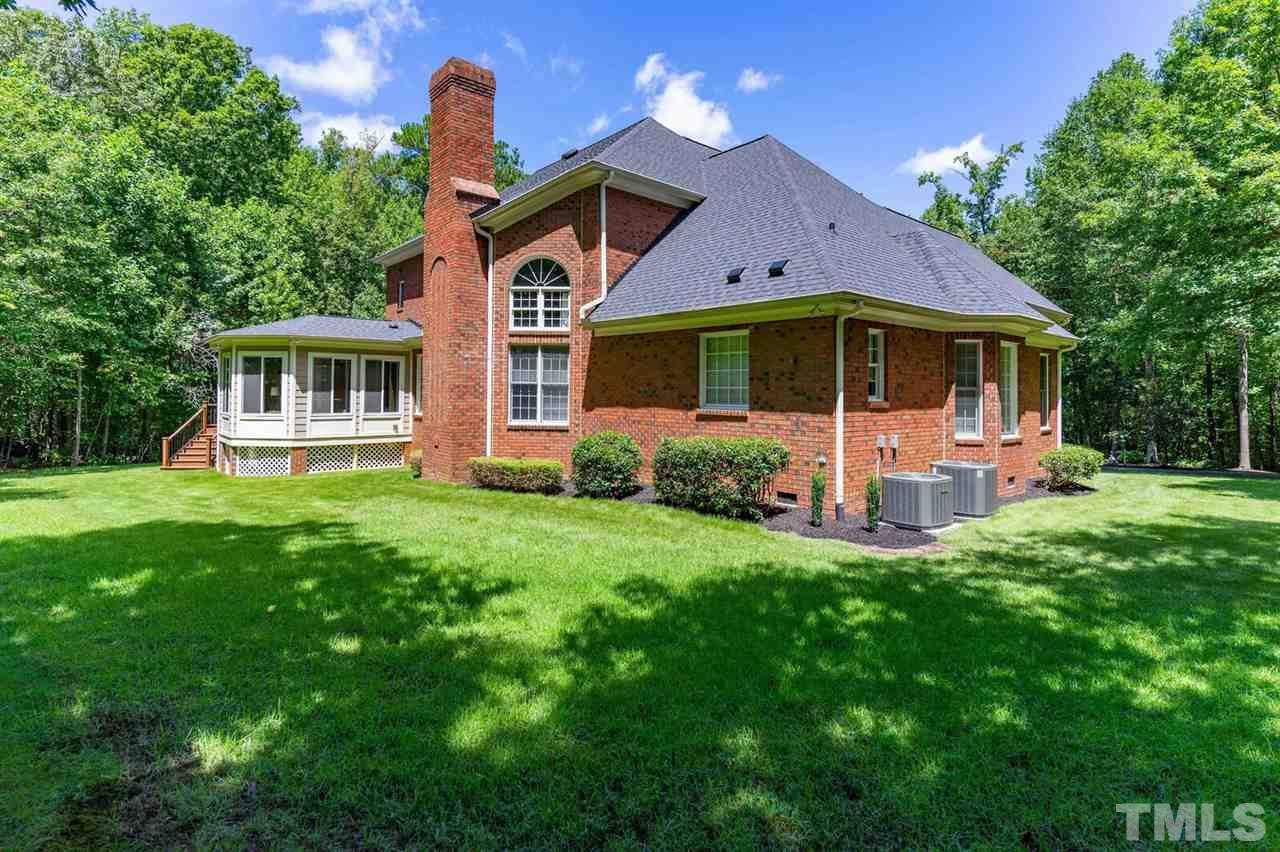All brick home and exterior brick fireplace.