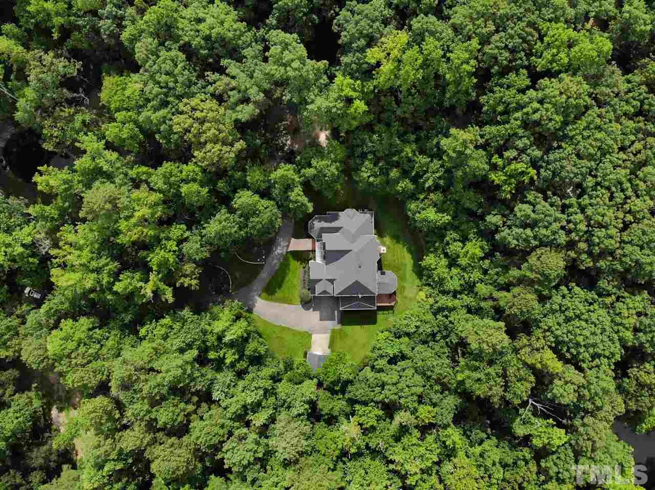 Aerial view of house and 6 acres