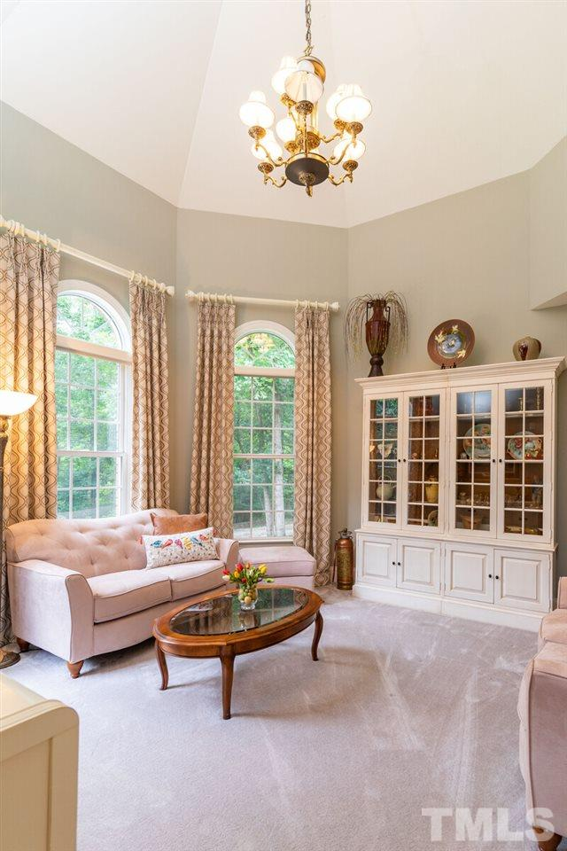 Great office space/ seating space with high ceilings and large window to the front of the house.