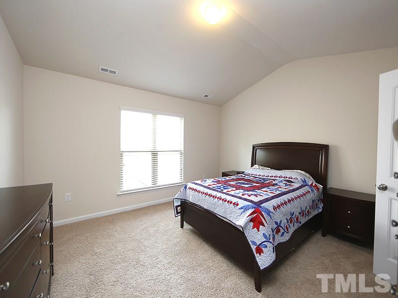 The master bedroom has a vaulted ceiling and is wired for a fan. Great wall space!