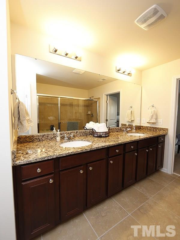 The granite top vanity is large and offers tons of storage.  There is a linen closet and the master closet is huge!