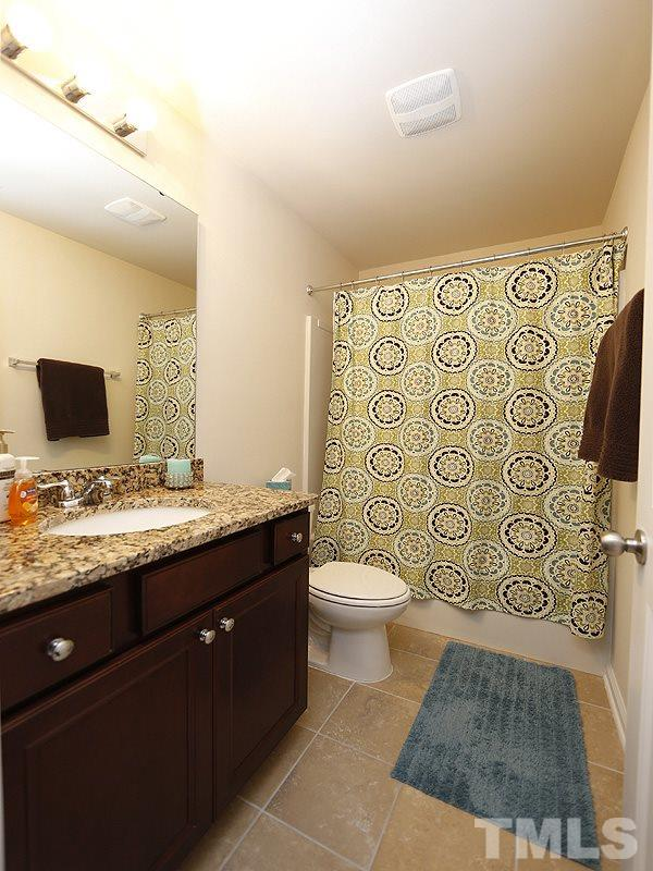 The hall bathroom has a tub/shower and granite on the vanity.