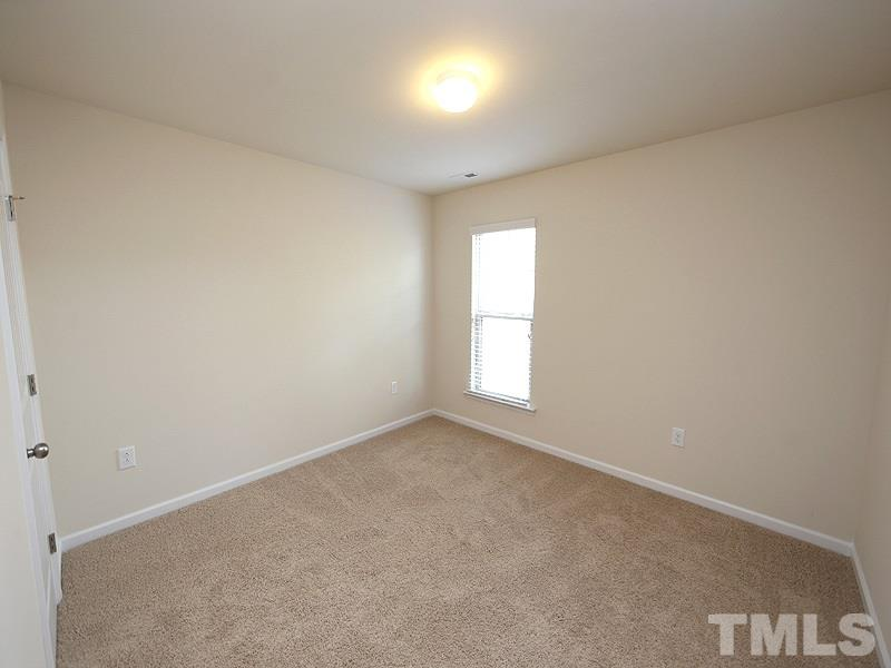 The third bedroom is ready for the new owners' furnishings.