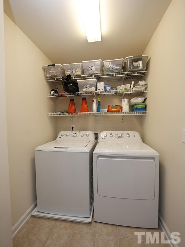The laundry room is conveniently located on the second floor close to the bedrooms.