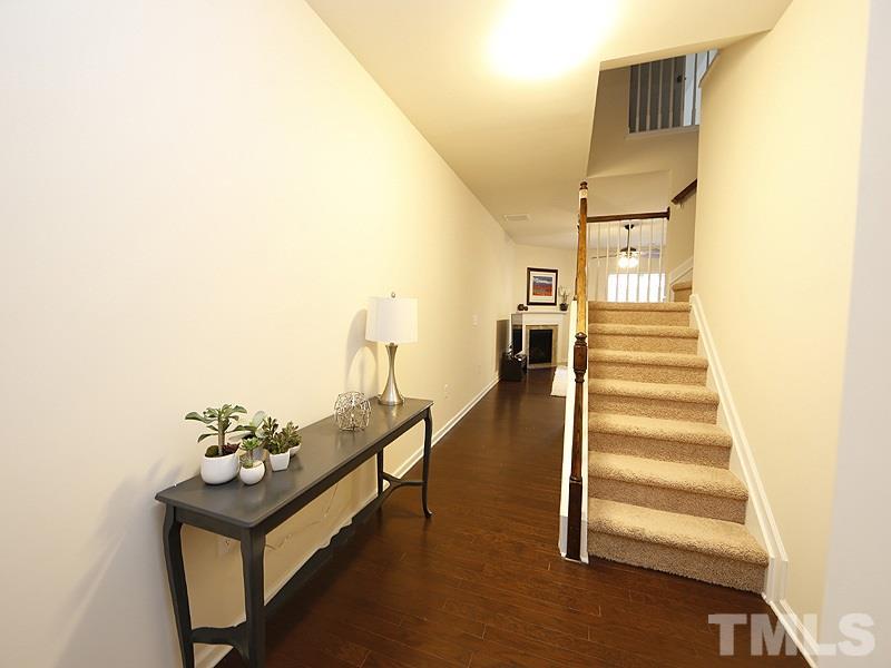 Enter into the lovely foyer  Hardwoods grace the main floor living space.