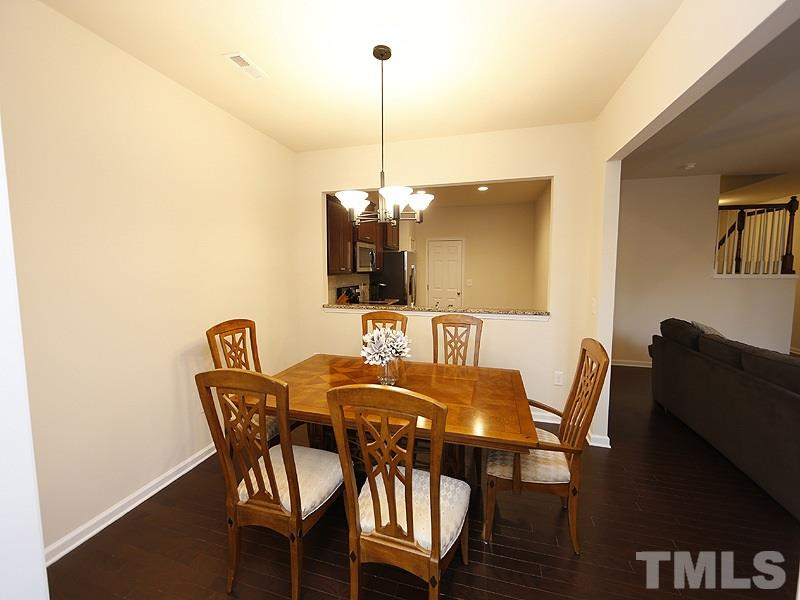 The dining room has a pass through to the kitchen and is also open to the living room and sun room.