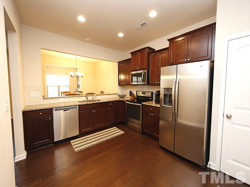 What a fabulous kitchen with beautiful cabinetry, granite counters, stainless appliances and tile backsplash.  There is a pantry and room for a table or piece of furniture in the kitchen.