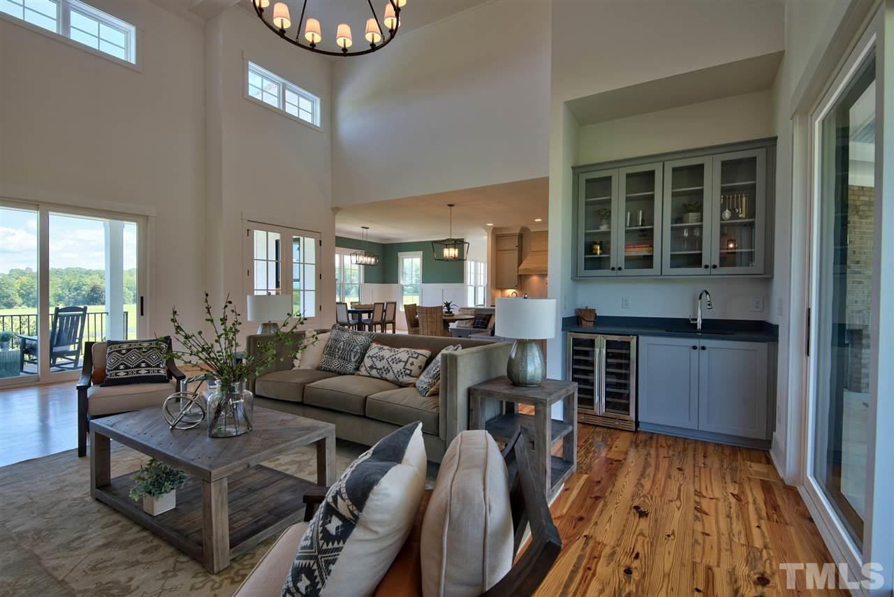 Cozy into this bright welcoming space which is open to covered porch with 2nd fireplace.