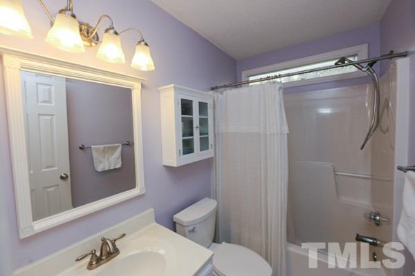 Refreshing Secondary Bathroom with Newer Kohler Cimarron Comfort Height Toilet.
