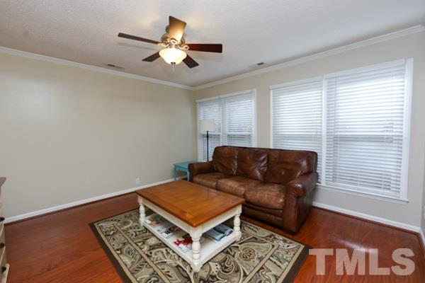 Secondary Living Space on Main Floor with Ceiling Fan and Beautiful Views to the Private Backyard.