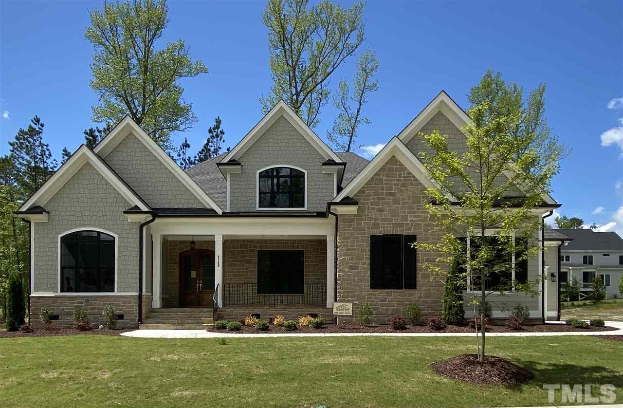 custom black windows (white on interior side!) and stone detail are just the start of all of the custom details this home has to offer!
