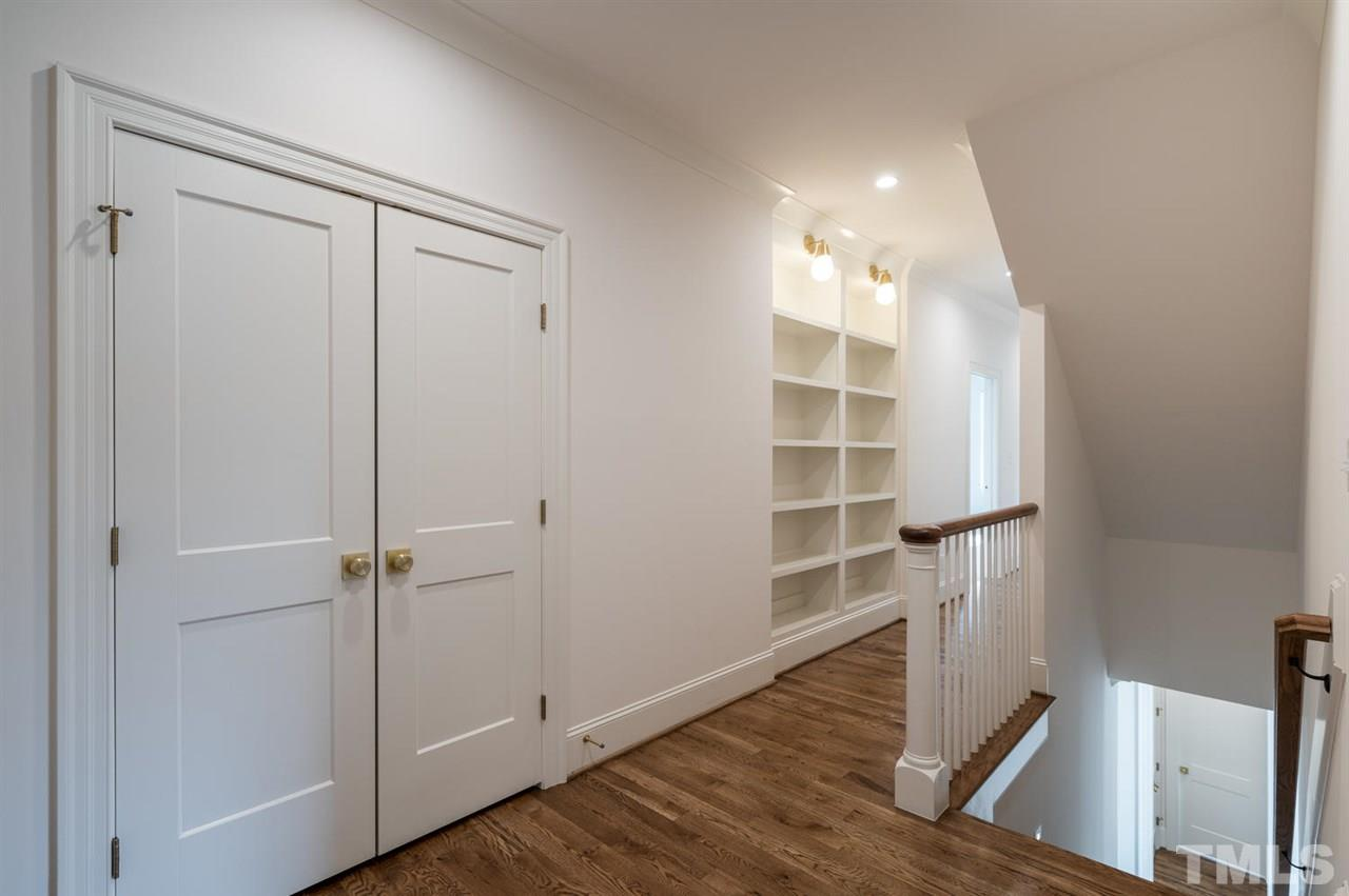 custom built-ins with accent lighting in upper hallway