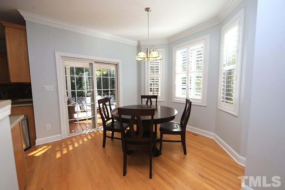 Plantation shutters, hardwoods, access to back porch.