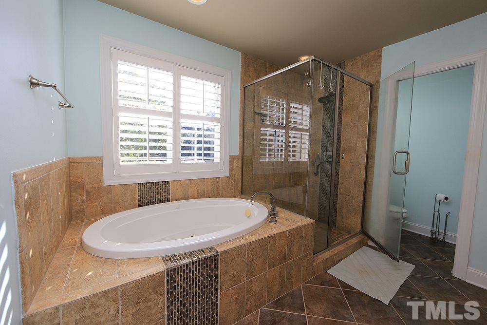 Whirlpool tub, generous shower, separate water closet.