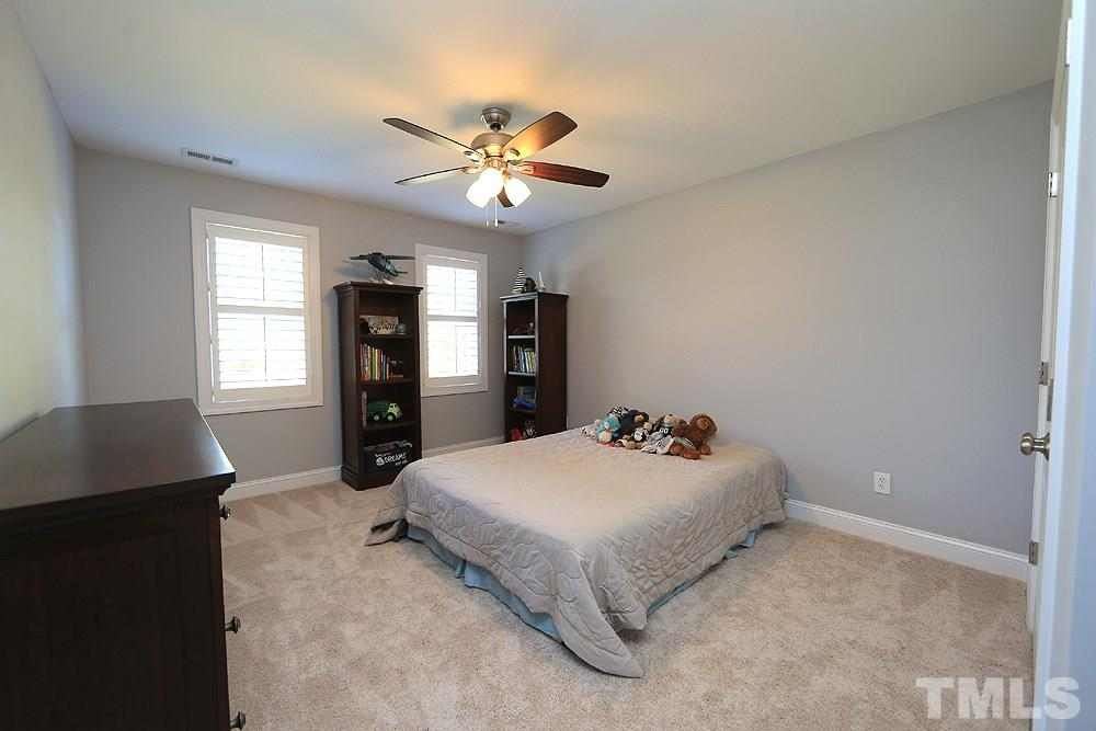 Front corner secondary bedroom with new carpet.