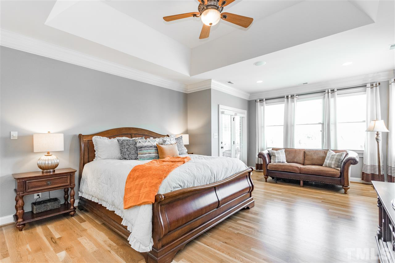 Large master bedroom with sitting area.