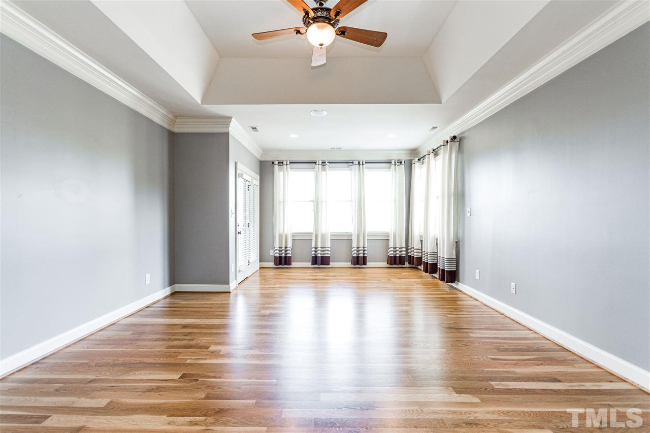 Large master bedroom without furniture boasts of the beautiful new hardwood floors (2017), heavy trim and tray ceiling.