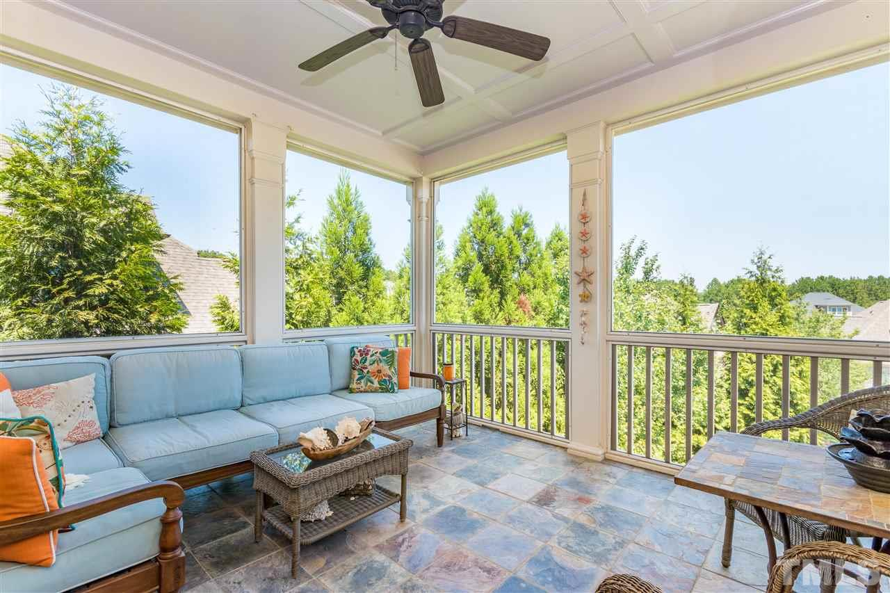 Private screened porch directly off master suite is an owner's dream.