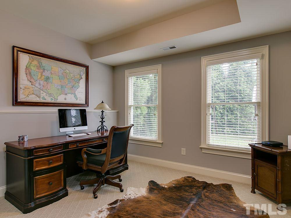 Bedroom #6 in the basement can be used as a private office or for multi-generational living. It has direct access to a full bathroom.