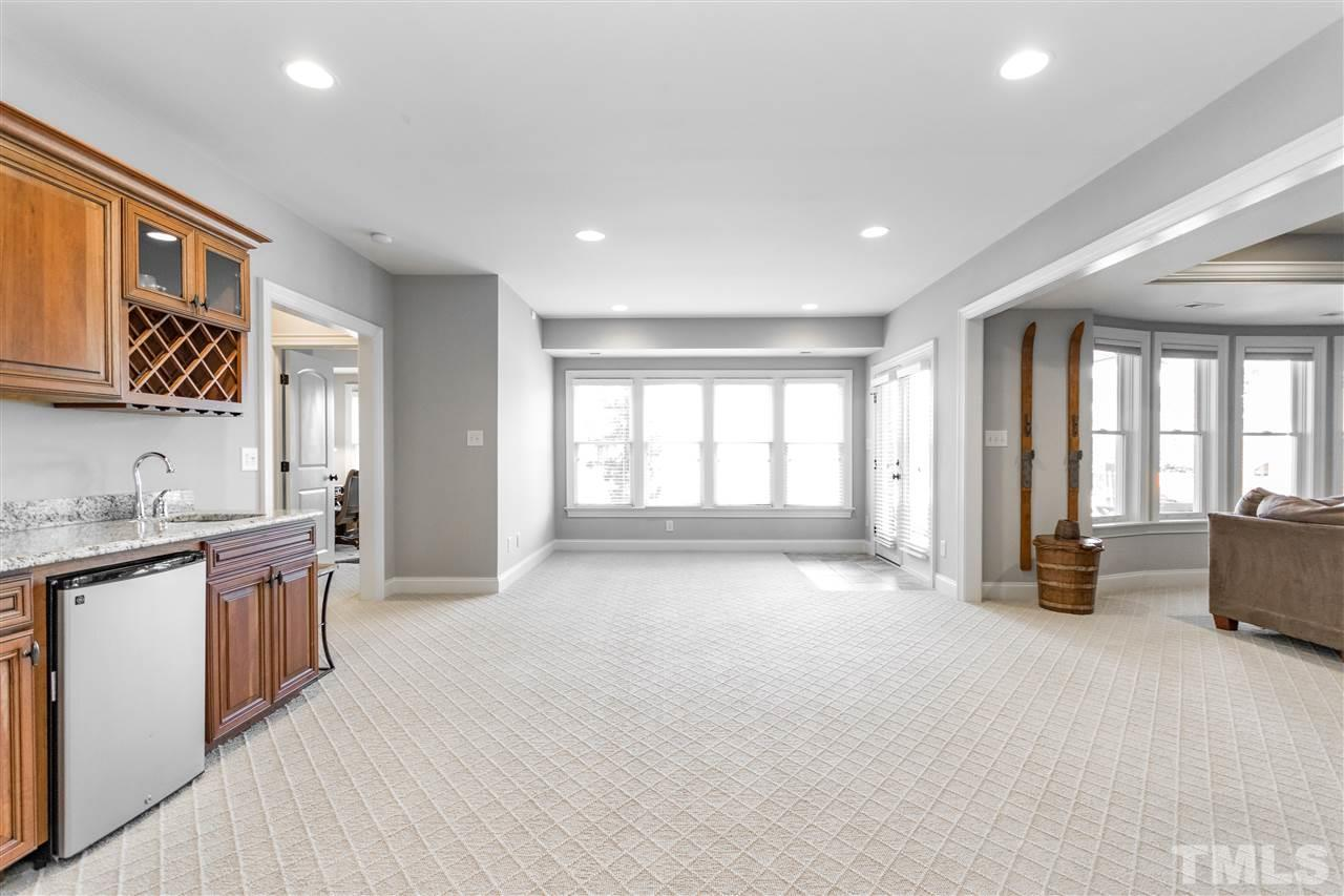 Open space in the basement complete with a wet bar and perfect for games.