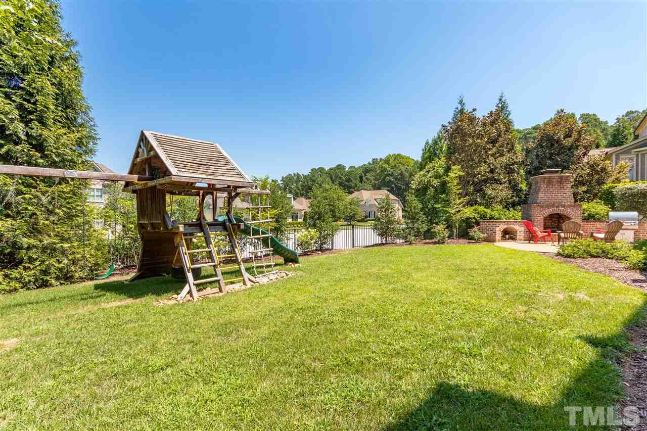 Large flat yard that is fully gated and lined with privacy trees. The Nellie Stevens Holly trees will mature to create a privacy border in the back of the home.