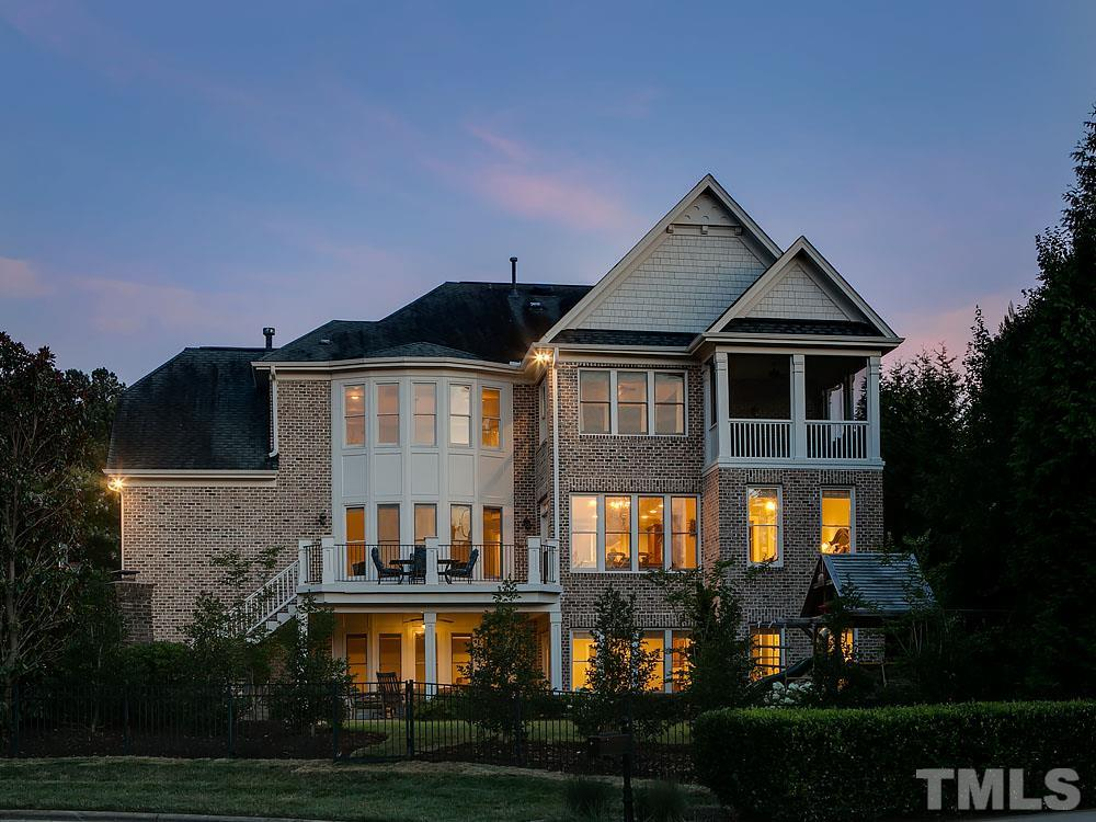 Beautiful twilight view of the rear of the home.