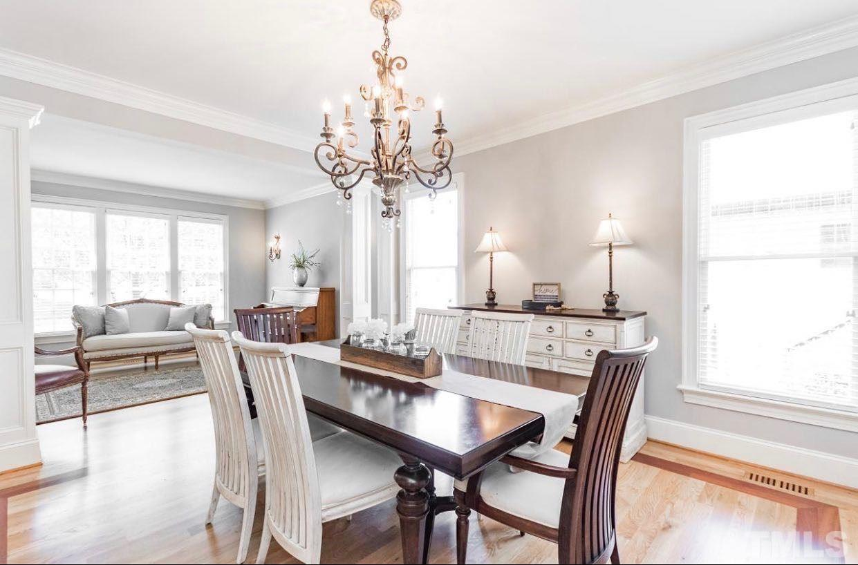 Formal dining room with superior details including beautiful inlay hardwood floors.